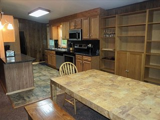 Large Lakefront--Hot Tub, Pool Table, WIFI, Firepit, Boats--