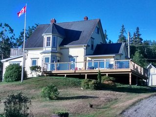 Lovely, large family home in idyllic Southwest Cove with castle view