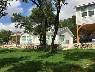 Medina Lake Escape Water Front Retreat: gentle slope to the water w/private dock