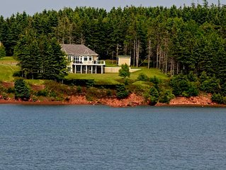 Souris Beach House right at water's edge and rated as a luxury accommodation.