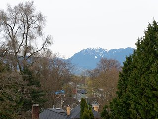 Extraordinary city and mountain view from upstairs suite in Kitsilano house