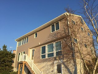 Newly renovated 4 br house a block from the beach with waterfront views