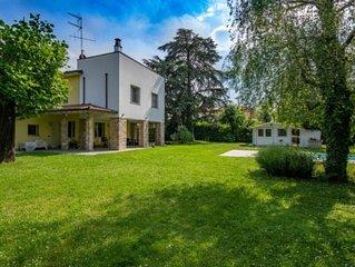 Villa di testa a m50 dal lago con giardino, area wellness e piscina privata.