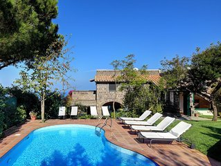 Spectacular sea views from this traditional garden villa with pool