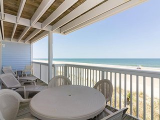 Watch the children play in the sand from the decks of this oceanfront condo