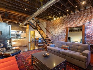 Striking Three Story Downtown Loft w Private Rooftop Deck and Free Garage Pkg