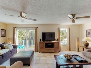 Island-style townhome with shared pool only moments from the beach!