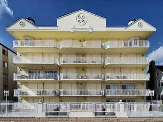 Oceanfront condo overlooking boardwalk, private pool, and steps to the beach