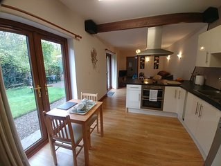 The Basement is a self-contained ground floor apartment set in 2 acres of garden