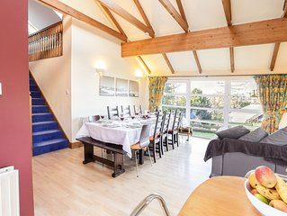 Capacious kitchen-living area with comfy seating - ideal for entertaining