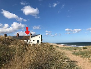 One Coastguard Cottage - on Caister's sandy beach