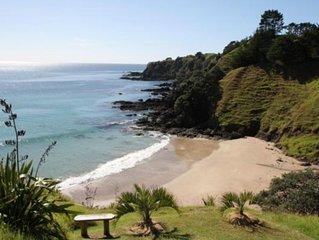 Sandy beach Mahinepua