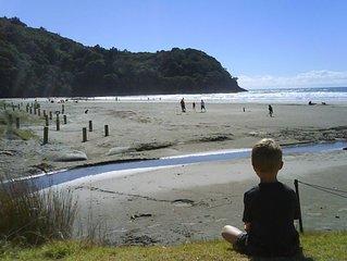 Beachfront, near new, big views, north end.