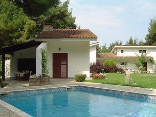Exclusive villa with private swimming pool surrounded by woods