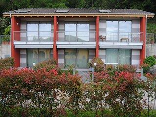 Appartamento 'Azzurro' in Villetta con vista lago, parcheggio e spiaggia privata