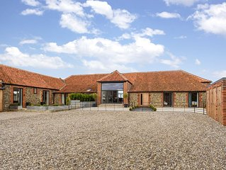 WOW! - A truly exceptional modern barn conversion with stunning rural views
