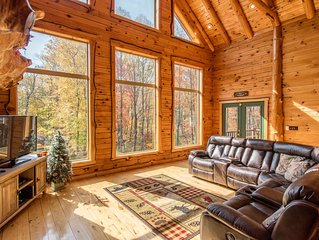 Custom-built cabin with double sided fireplace and wall of windows! Easy access