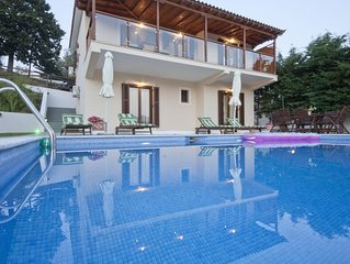 Luxurious villa with private pool, garden and mountain views and the olive grove