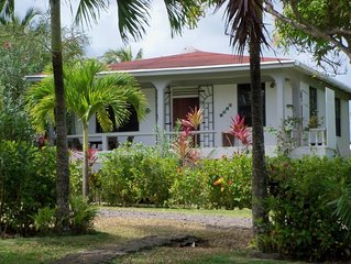 Peaceful, fully equipped two bedroom cottage overlooking the sea in Calibishie,