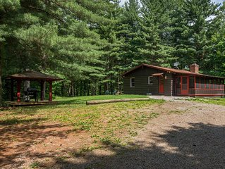 Charming 2 bedroom cabin with 110 acres, screened hot tub porch, private pond, a