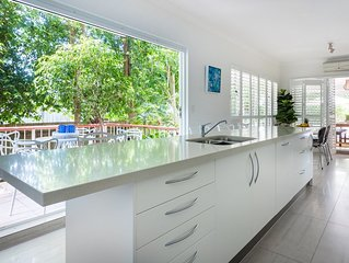 Island Kitchen Bench spilling out to balcony in tropical setting