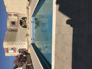 Cost apartment with pool, up the road from the sea and mediterraneo water park