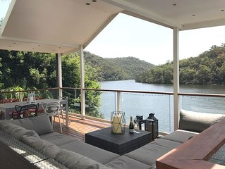 Absolute waterfront modern property with boat and outside hot tub