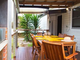 House- sunny decks. Walk to Flynn's beach. No extra fees for linen or cleaning.