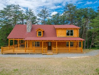 Newer 4 bedroom lodge with private acreage and close proximity to Cantwell Cliff