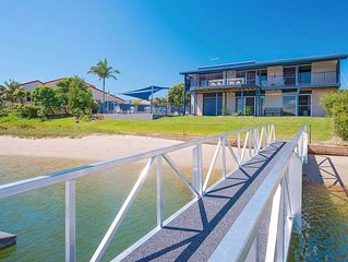 Stunning double story beach house on the waterfront with a pontoon and swimming