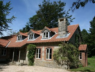 Stunning setting in rural Dorset near the Jurassic coast for 12 people and pets.