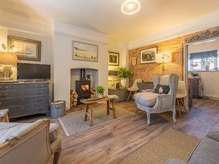 Luxurious and stylish Grade II listed 300 year old flint cottage