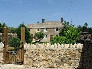 Roseleigh Cottage in the heart of Stow-on-the-Wold with parking for 2 cars.