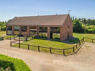 Owl Barn sleeps up to eight people in Norfolk and welcomes children,  close to t