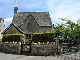 A Quaint Grade 11 Listed Detached Stone Cottage In Lower Slaughter with parking.