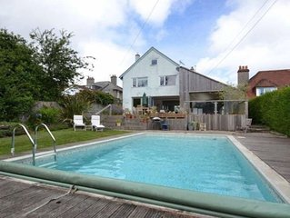 5 bed, heated pool May-mid Oct, walk to beach, sea views, modern family house