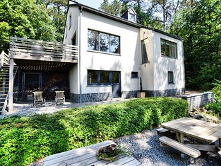 Beautiful, modern house with stunning views, hot tub and sauna in green surround