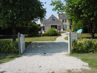 Maison avec jardin verdoyant