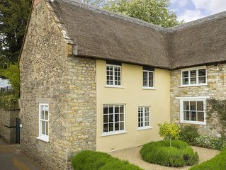 Pear Tree Cottage is a Grade II thatched cottage in the Dorset village of Nether