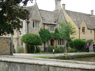 Fairlie Cottage Overlooks the River in Bourton-on-the-Water parking for 3 cars.