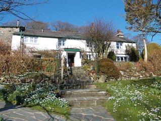 Delightful 17C cottage, ensuites - idyllic setting, lovely garden, lake frontage