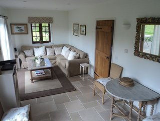 Stunning 5 Star cottage set in 4 acres in AONB. Close to beach/harbour. Sleeps 4