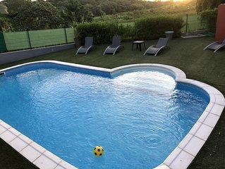 Maison mitoyenne avec piscine  à Ducos (centre sud)