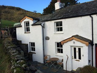 CHARACTERFUL LAKELAND COTTAGE  .  WIFI,SKY TV, LOG FIRES, PRETTY LOCATION.
