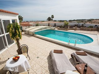 Spacious 2 bedroom holiday home with heated pool, lovely sea / mountain views