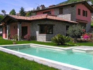 Relax e comfort in appartamento in villa, splendida vista lago e piscina privata