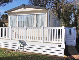 A PEACEFUL 2 BED STATIC CARAVAN IN A 5* RESORT 5 MINUTES WALK FROM THE BEACH