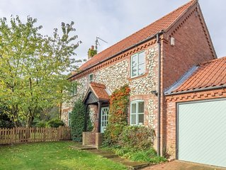 An attractive brick and flint modern detached house in a quiet location.