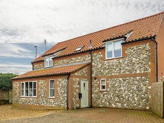 A beautifully presented contemporary four-bedroom house in an attractive village