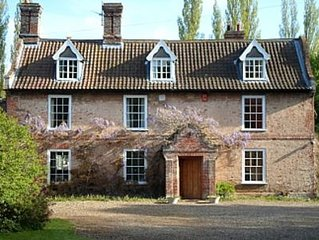 An 18th Century Rectory With River Frontage set in 2 acres of private gardens